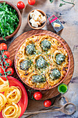 Pasta nests with meatballs, pesto and tomato cream sauce