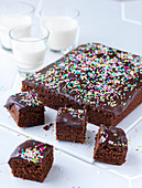 Chocolate tray bake cake with chocolate glaze and sprinkles
