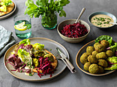 Green falafel with beetroot, salad and pita