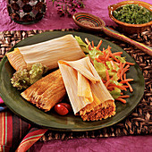 Ground Pork Tamales in corn husk wrappers