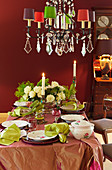 Table festively set in green, claret red and pink