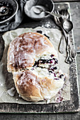 Homemade blueberry bun topped with icing