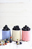 Blackberries in ceramic cups