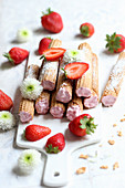 Wafer rolls filled with strawberry cream