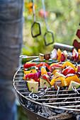 Vegan vegetable kebabs on a barbecue