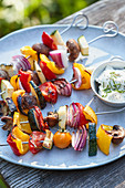 Grilled vegetable kebabs with a herb and quark dip