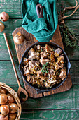 Pork and onion stew with thyme