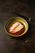 Sea bream sashimi with truffle (Japan)