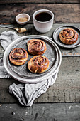 Kanelbullar - Swedish cinnamon buns served with black coffee