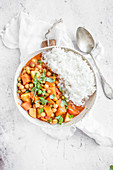 Thai vegan red curry made with chickpeas, sweet potato, carrot, green peas, red thai curry paste and coconut milk