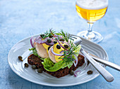 Pumpernickel with boiled cod roe and capers