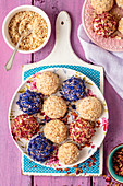 Quark, mascarpone and chocolate balls - mini nobake cheesecakes with nuts and flower petals