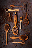 Coffee beans and Ground Coffee on various Wooden Spoons
