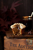 Cut into sticky toffee cupcake with sauce dribbling down it