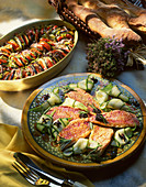 Rosemary red mullet fillets on a courgette salad served with a Provençal vegetable gratin