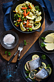 Salmon with lemons and steamed vegetables A healthy dish