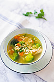 Chicken soup with pasta and vegetables
