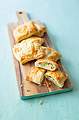 Stuffed puff pastry parcels filled with vegetables, ham and cheese