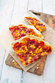 Pizza with sweetcorn, pepper and salami
