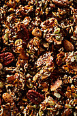 Caramelised granola with seeds, nuts and white sesame seeds