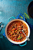 Pork and bean casserole with sage and tomatoes