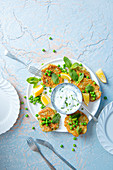 Courgette and pea fritters with lemon and minted yoghurt dip