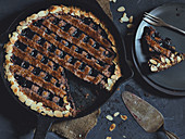 Linzer Torte (nut and jam layer cake) made in a cast-iron pan