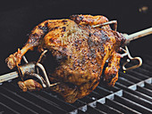 Corn-fed chicken on a roasting spit