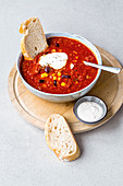 Vegetarian chilli with ciabatta and sour cream