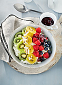 A fruit bowl with rice pudding and coconut