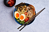 Ramen soup with mushrooms, chashu pork and ajitama ramen eggs