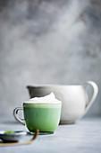 Matcha latte drink on a gray bakground
