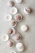 Coconut truffles in patty papers.