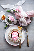 Gift wrapped in fabric and posies of pink carnations