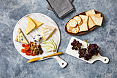 Cheese board with crackers and grapes