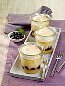 Mini cheesecake with blueberries and meringue baked in glasses