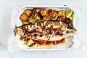 Citrus Stuffed Rainbow Trout with Coocnut and Shallot Topping
