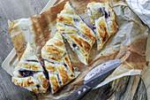 Blueberry strudel on baking paper