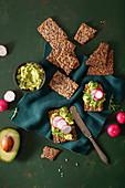 Keto crispbread with avocado cream and radishes