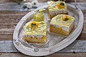 Vegan poppyseed cheesecake with pineapple, mango and lemon curd