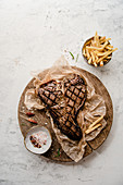 Grilled t-bone steak with chips