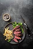 Grilled t-bone steak with rocket and chips