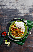 Kaukswe (lamb curry with noodles, egg and herbs, Myanmar)