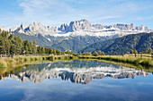 Wuhnleger pond with a view of the 'Rose Garden', South Tyrol, Italy
