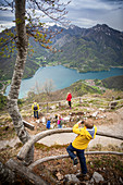 A hike with children with a view of Lake Ledro, Valle di Ledro, Trentino, Italy