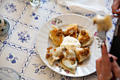 Pierogi with a spinach and cottage cheese filling and sour cream