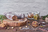 Traditional homemade chocolate salami with hazelnuts and pistachios
