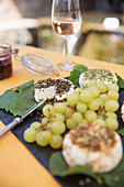 Goat's cream cheese and grapes served on vine leaves