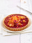 Pomegranate and kumquat tart