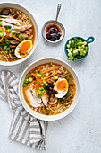 Top view of Japanese noodle soup ramen in white bowl